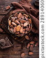 Cocoa beans and chocolate on wooden background 28914060