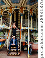 adult man and woman on a carousel 28931876