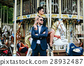adult man and woman on a carousel 28932487