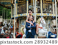 adult man and woman on a carousel 28932489