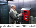 Senior woman in elevator on train station 28939440