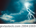 Lightning strike on the dark cloudy sky 28941069
