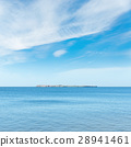 blue sea and sky with clouds. island on horizon 28941461