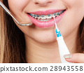 Woman with braces having dentist appointment 28943558