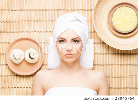Beautiful and healthy woman in a spa salon 28945764