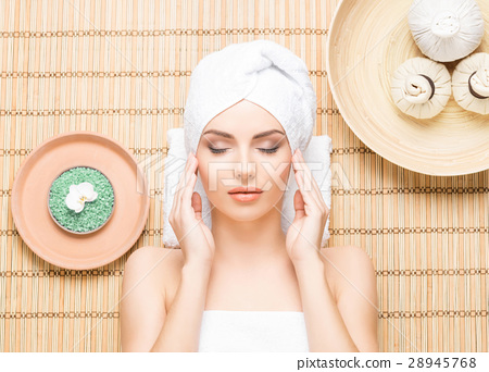 Beautiful and healthy woman in a spa salon 28945768