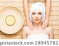 Beautiful and healthy woman in a spa salon 28945782