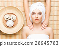 Beautiful woman in s spa salon on a bamboo mat 28945783