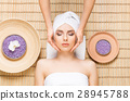 Beautiful woman in s spa salon on a bamboo mat 28945788