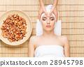 Beautiful woman in s spa salon on a bamboo mat 28945798