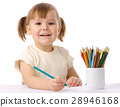 Cute child draws with color pencils 28946168