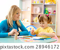 Teacher with child in preschool 28946172
