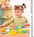 Little girl play with building bricks in preschool 28946304