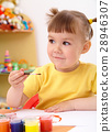 Child draws with paints in preschool 28946307