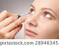 Applying eyeshadow for young girl 28946345