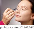 Applying eyeshadow for young girl 28946347