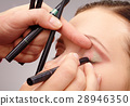 Applying eyeshadow for young girl 28946350