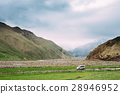 SUV Car On Off Road In Summer Mountains Landscape 28946952