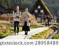Women traveling in the architecture with joint formation 28958489