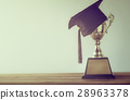 graduation cap with champion golden trophy  28963378
