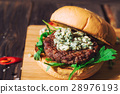 Fresh burger with blue cheese and arugula 28976193
