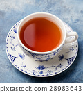 Cup of tea on a blue stone background. Copy space 28983643