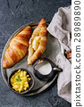 Breakfast with croissant and mango fruit 28989890