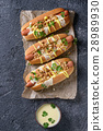 Hot dogs with cheese sauce and mustard 28989930