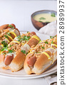 Hot dogs with cheese sauce and mustard 28989937