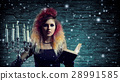 Beautiful witch making the witchcraft 28991585