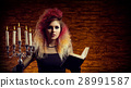 Beautiful witch making the witchcraft 28991587
