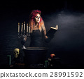 Beautiful witch making the witchcraft 28991592