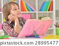 Boy doing homework 28995477