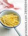 Raw italian pasta. 28996044