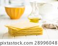 Raw lasagne sheets. 28996048