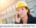 Young Professional Female Contractor Wearing Hard Hat at Contruc 28996791