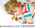 little blond kid boy in colorful nightwear clothes 28996888