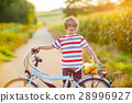 Shool kid boy having fun with riding of bicycle 28996927