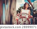 Stylish wealthy woman on a luxury wooden regatta 28999071