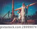 Stylish wealthy women on a luxury yacht 28999074