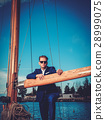 Stylish wealthy man on a luxury wooden regatta 28999075