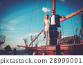Stylish wealthy couple on a luxury yacht 28999091