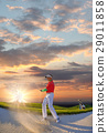 Man playing golf against sunset 29011858