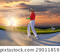 Man playing golf against sunset 29011859