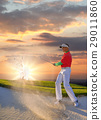 Man playing golf against sunset 29011860