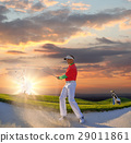 Man playing golf against sunset 29011861