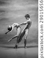 Couple of ballet dancers posing over gray 29015656