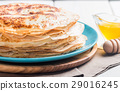 Stack of yeast pancakes 29016245