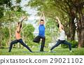 Performing yoga 29021102