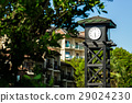 clock on a wooden tower  29024230